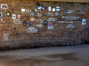 part of the dogs memorial wall underneath the arches